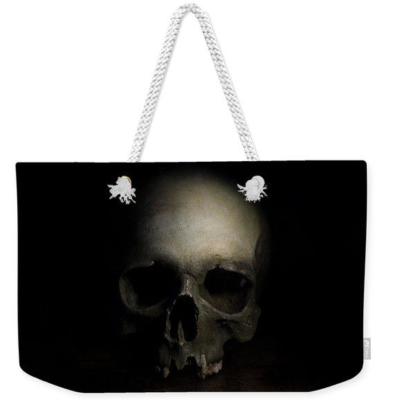 Weekender Tote Bag featuring the photograph Male Skull by Jaroslaw Blaminsky
