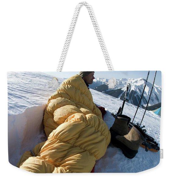 Man In Sleeping Bag On Summit Weekender Tote Bag