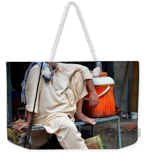 Man Sits And Relaxes In Lahore Walled City Pakistan Weekender Tote Bag