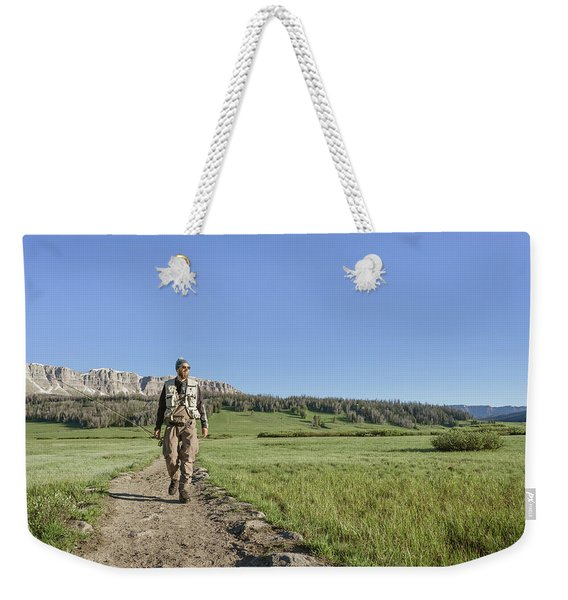 Man Walking With Fishing Rod Weekender Tote Bag