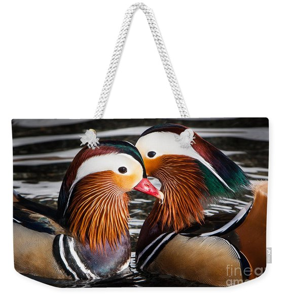 Weekender Tote Bag featuring the photograph Mandarin Lovers by John Wadleigh