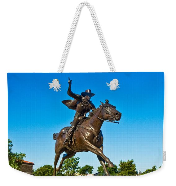 Weekender Tote Bag featuring the photograph Masked Rider Statue by Mae Wertz