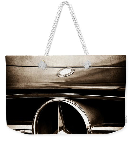Weekender Tote Bag featuring the photograph Mercedes-benz Grille Emblem by Jill Reger