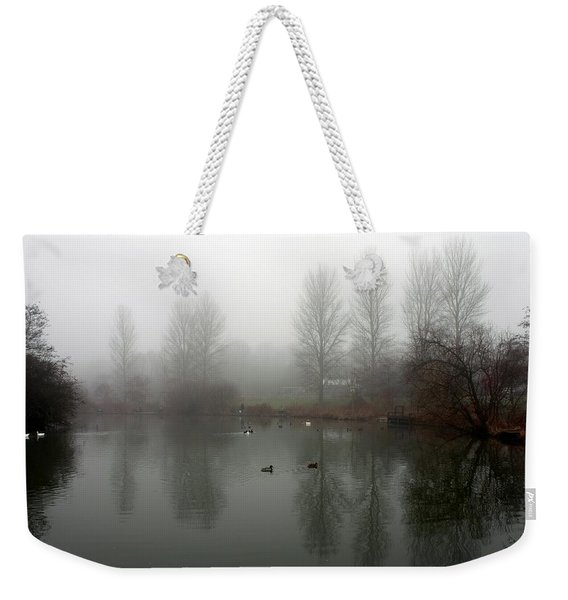 Weekender Tote Bag featuring the photograph Misty Lake Reflections by Jeremy Hayden