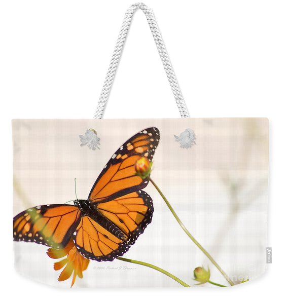 Weekender Tote Bag featuring the photograph Monarch Butterfly In Flight by Richard J Thompson