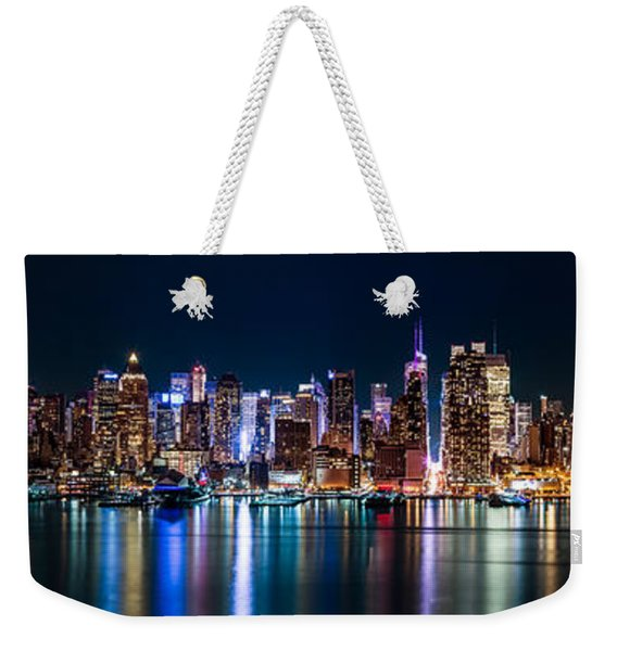 Weekender Tote Bag featuring the photograph New York Panorama By Night by Mihai Andritoiu