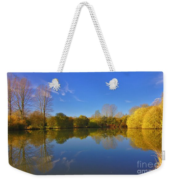 Weekender Tote Bag featuring the photograph November Lake 1 by Jeremy Hayden