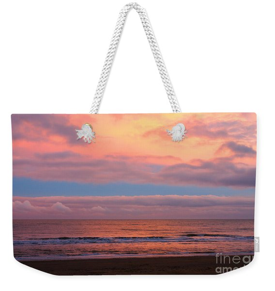 Weekender Tote Bag featuring the photograph Ocean Sunset by Jeremy Hayden