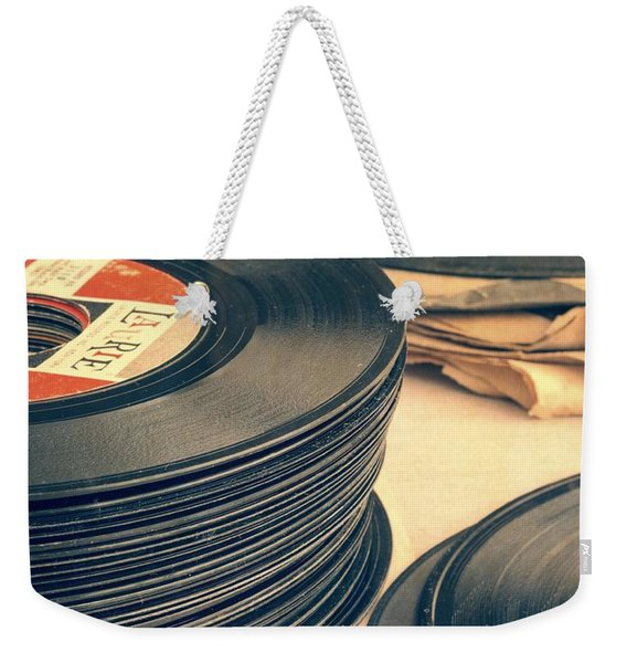 Weekender Tote Bag featuring the photograph Old 45s by Edward Fielding
