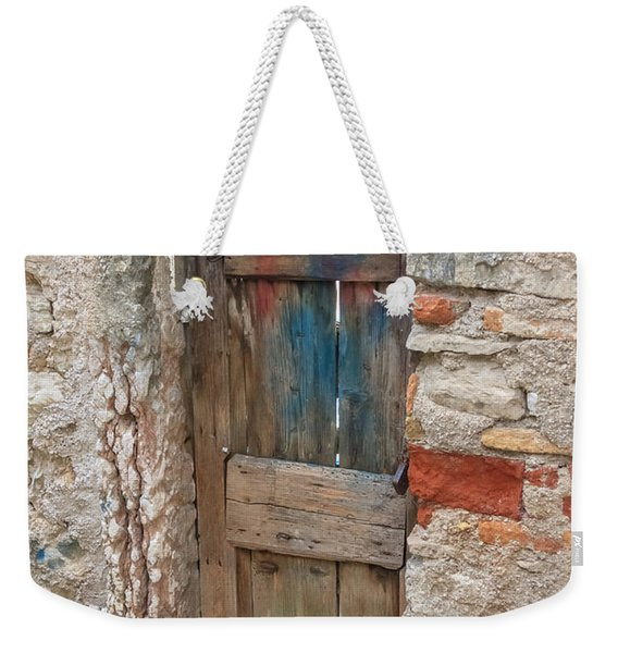 Weekender Tote Bag featuring the photograph Old Door by Susan Leonard