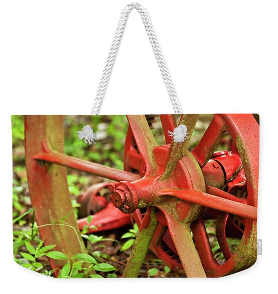 Weekender Tote Bag featuring the photograph Old Farm Tractor Wheel by Carolyn Marshall