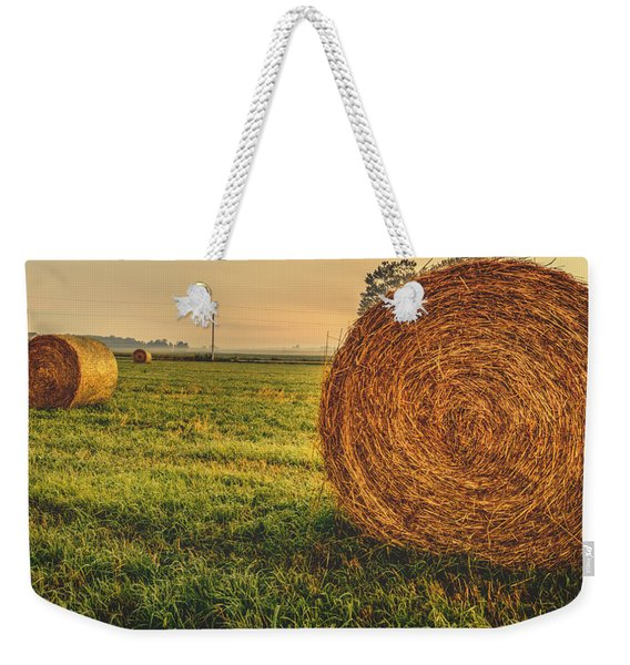 Weekender Tote Bag featuring the photograph On The Field  by Garvin Hunter