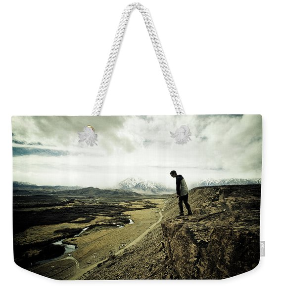 One Man Looks Down The Cliff Face Weekender Tote Bag