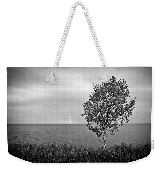 Weekender Tote Bag featuring the photograph One On One  by Doug Gibbons
