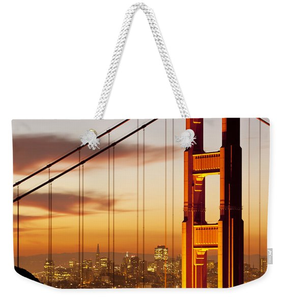 Weekender Tote Bag featuring the photograph Orange Light At Dawn by Brian Jannsen