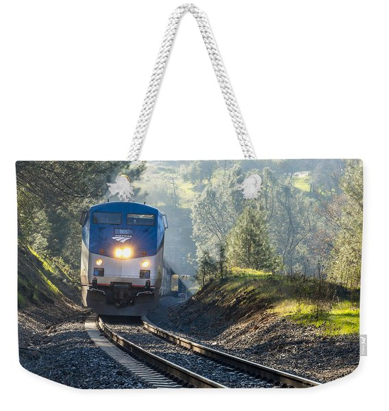 Weekender Tote Bag featuring the photograph Out Of The Mist by Jim Thompson