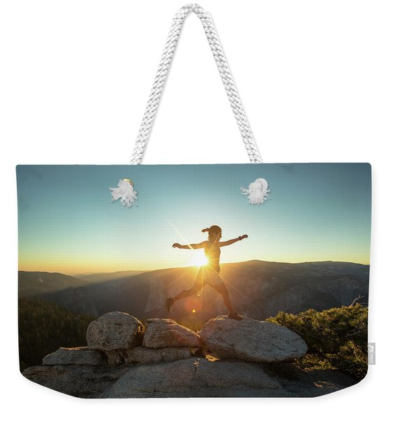Person Leaping Along Rocks At Sunset Weekender Tote Bag