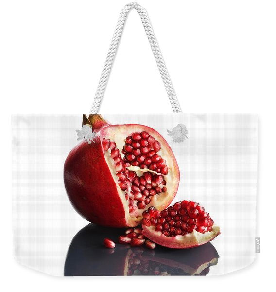 Pomegranate Opened Up On Reflective Surface Weekender Tote Bag