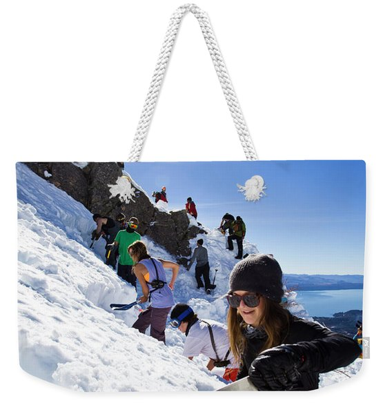 Professional Skier Using A Snow Saw Weekender Tote Bag