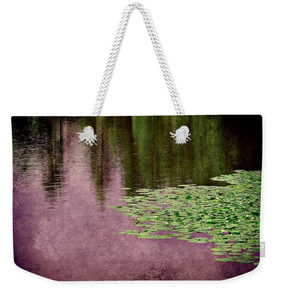 Weekender Tote Bag featuring the photograph Purple Pond Reflections by Patricia Strand