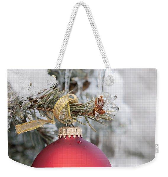 Red Christmas Ornament On Snowy Tree Weekender Tote Bag