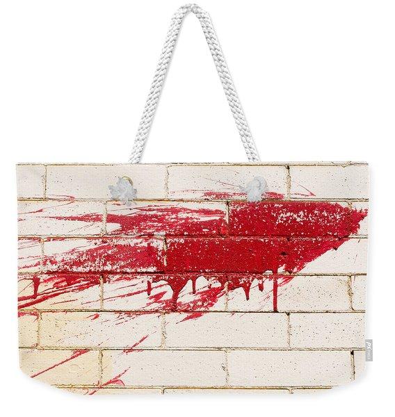 Red Splash On Brick Wall Weekender Tote Bag