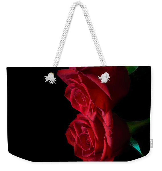 Weekender Tote Bag featuring the photograph Reflecting Beauty by Garvin Hunter