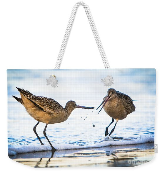 Weekender Tote Bag featuring the photograph Sanderlings Playing At The Beach by John Wadleigh