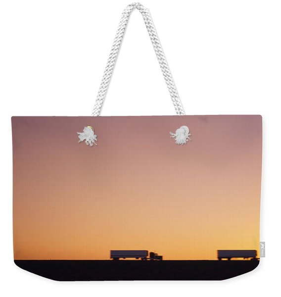 Silhouette Of Two Trucks Moving Weekender Tote Bag