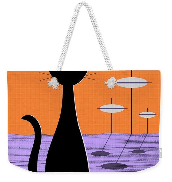 Weekender Tote Bag featuring the digital art Space Cat Orange Sky by Donna Mibus