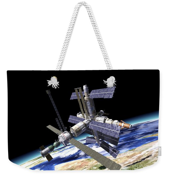 Space Station In Orbit Around Earth Weekender Tote Bag