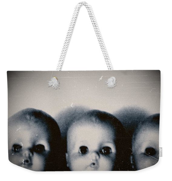 Weekender Tote Bag featuring the photograph Spooky Doll Heads by Patricia Strand