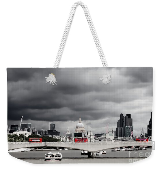 Weekender Tote Bag featuring the photograph Stormy Skies Over London by Jeremy Hayden