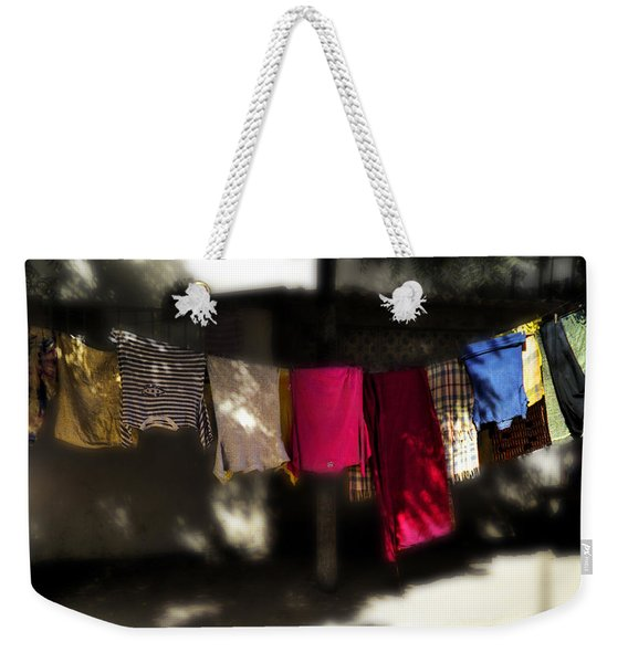Weekender Tote Bag featuring the photograph Sun Dry In Senegal by Wayne King