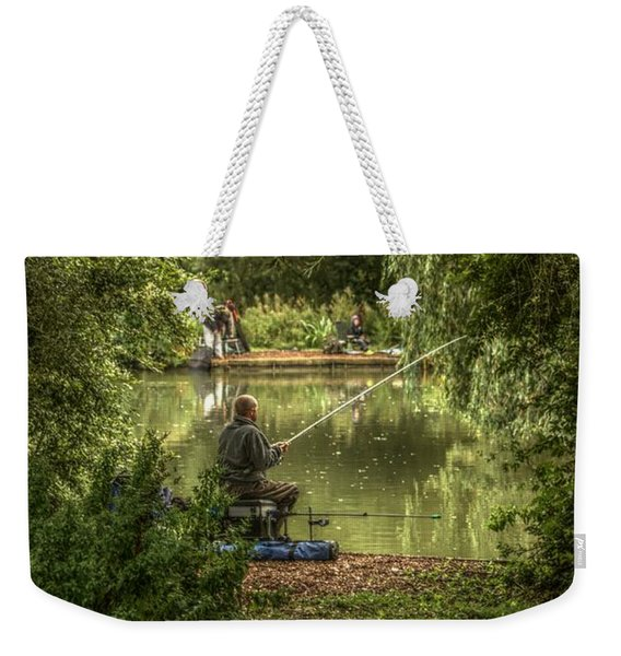 Weekender Tote Bag featuring the photograph Sunday Fishing At The Lake by Jeremy Hayden
