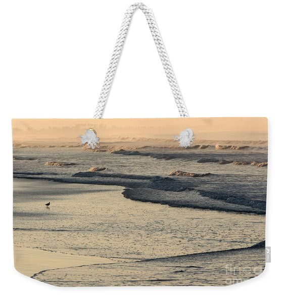 Weekender Tote Bag featuring the photograph Sunrise On The Ocean by John Wadleigh