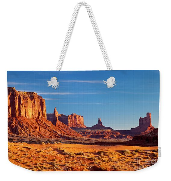 Weekender Tote Bag featuring the photograph Sunrise Over Monument Valley by Brian Jannsen
