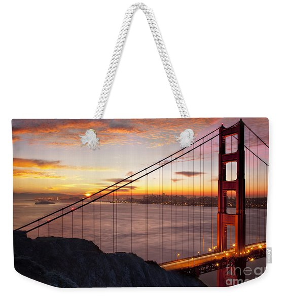 Weekender Tote Bag featuring the photograph Sunrise Over The Golden Gate Bridge by Brian Jannsen