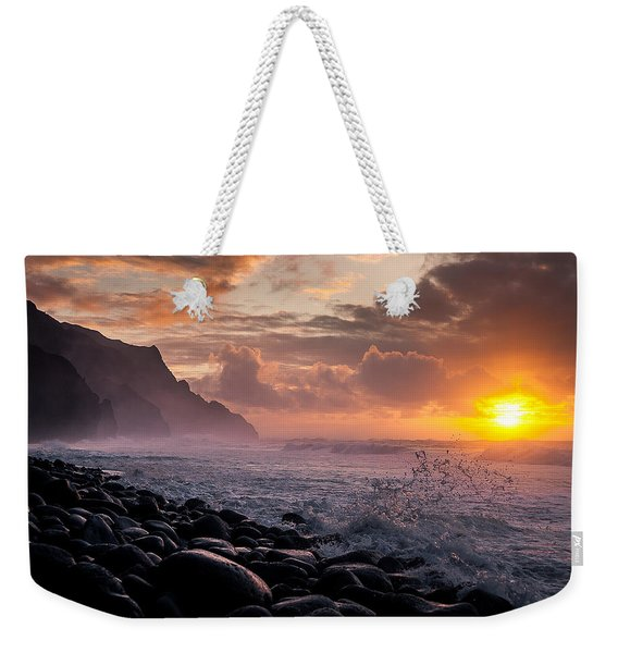 Weekender Tote Bag featuring the photograph Sunset On The Kalalau by Tim Newton