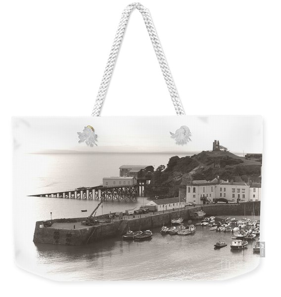 Weekender Tote Bag featuring the photograph Tenby Harbour And Castle Hill Vignette by Jeremy Hayden
