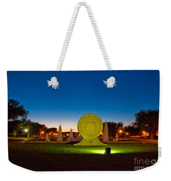 Weekender Tote Bag featuring the photograph Texas Tech Seal At Night by Mae Wertz