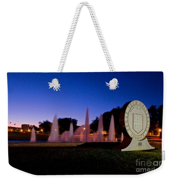 Weekender Tote Bag featuring the photograph Texas Tech University Seal And Blue Sky by Mae Wertz
