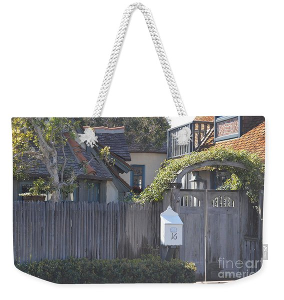 Weekender Tote Bag featuring the photograph The Courtyard  by Laurie Lundquist