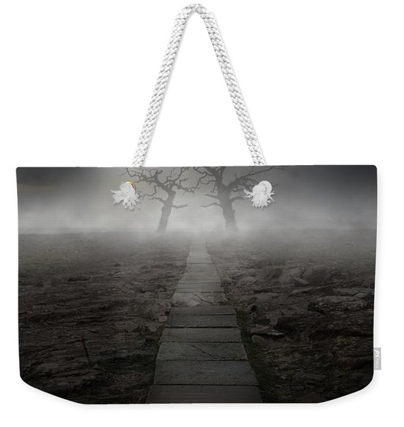 Weekender Tote Bag featuring the photograph The Dark Land by Jaroslaw Blaminsky
