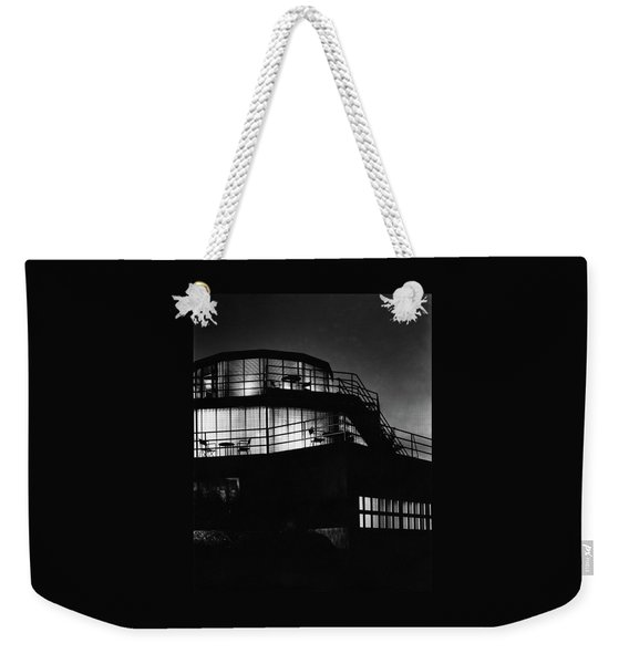 The Exterior Of A Spiral House Design At Night Weekender Tote Bag
