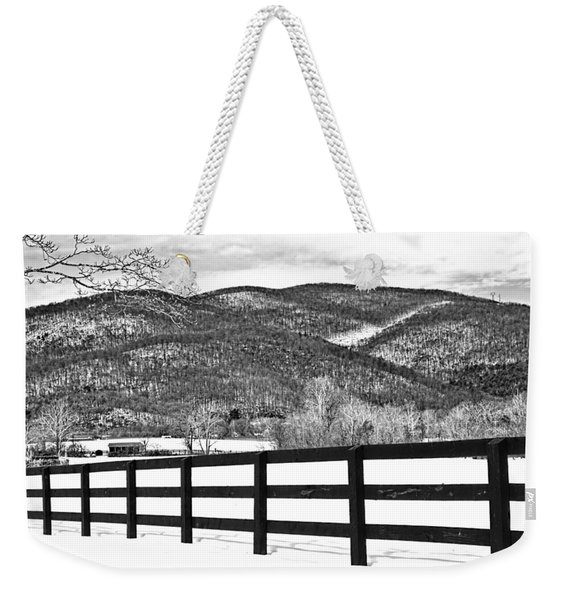 Weekender Tote Bag featuring the photograph The Fenceline B W by Jemmy Archer