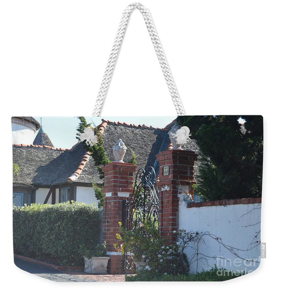 Weekender Tote Bag featuring the photograph The Gated Castle by Laurie Lundquist