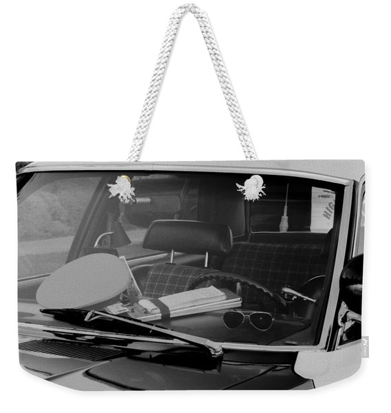 Weekender Tote Bag featuring the photograph The Office On Wheels by Jim Thompson