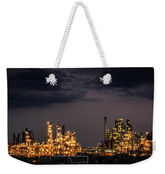 Weekender Tote Bag featuring the photograph The Refinery by Mihai Andritoiu