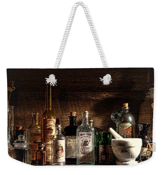 The Snake Oil Shop Weekender Tote Bag